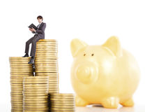 Young man counting coin in piggy bank Royalty Free Stock Photo