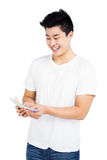 Young man counting currency notes Stock Images