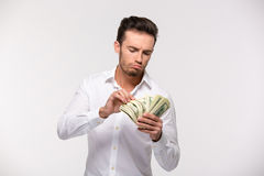 Young man counting money Stock Photos