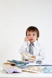 Young man, counting money and taking notes. Indoor Royalty Free Stock Photo