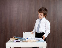 Young man, counting money and taking notes. Indoor Stock Photos