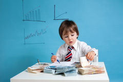 Young man, counting money and taking notes. Indoor Royalty Free Stock Photography