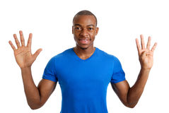 Young man counting to nine Royalty Free Stock Photo