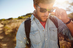 Young man on country hike Stock Photography