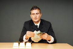 Young man counts money Stock Images
