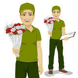 Young man courier holding bouquet of flowers Royalty Free Stock Photography
