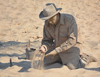 Young man cover his body of sand Royalty Free Stock Photo