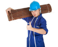 Young man in coveralls with wicker mat Royalty Free Stock Photography