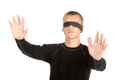 Young man with covered eyes Royalty Free Stock Images