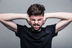 Young man covering his ears hands Royalty Free Stock Photo