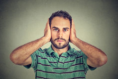 Young man covering his ears with hands Royalty Free Stock Photos