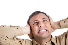 A young man covering his ears to shut out noise Royalty Free Stock Photos