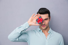 Young man covering his eye with gift box Royalty Free Stock Photo