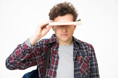 Young man covering his eyes with book Royalty Free Stock Image