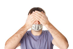 Young man covering his eyes with his hands and his Royalty Free Stock Photo