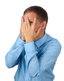 Young man covering his face Royalty Free Stock Photography