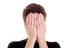 Young man covering his face Stock Photos