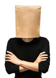 Young man covering his head using a paper bag. Stock Photo