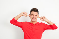 Young man covering his hears Royalty Free Stock Photography