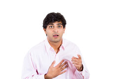 Young man covering his mouth with his hand in shock Stock Image