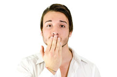 Young man covering mouth with hand, should not speak Royalty Free Stock Photos