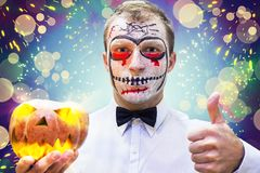 Young man on crazy Halloween party. Portrait of man in mask on holiday Halloween. Blood theme on Halloween. Concept of Halloween party Stock Photos