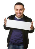 Young man with crazy smile. Young man holding a white blank billboard isolated on white background with crazy smile royalty free stock photo
