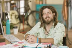 Young Man in a Creative Office. Professional young man in a creative office Stock Photo