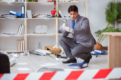 The young man during crime investigation in office Royalty Free Stock Photos