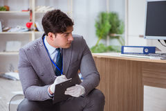 The young man during crime investigation in office Stock Photo