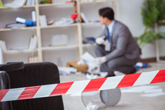 The young man during crime investigation in office Royalty Free Stock Photography