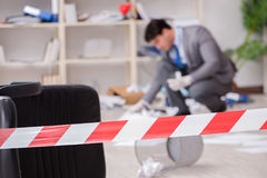 The young man during crime investigation in office Stock Photography