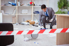 The young man during crime investigation in office Stock Photos