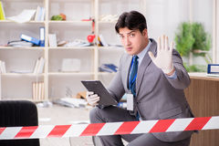 The young man during crime investigation in office. Young man during crime investigation in office royalty free stock photo
