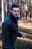 A young man of criminal appearance in a black leather jacket stock photography