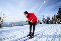Young man cross-country skiing Stock Photography