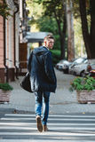 Young man cross the street royalty free stock photos