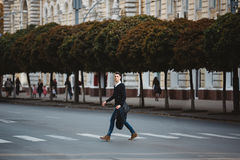 Young man cross the street Royalty Free Stock Photography