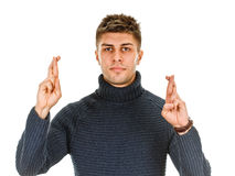 Young man crossing fingers, praying, christening Stock Photography