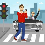 Young man crossing street sending sms while angry driver in black convertible car yelling at him. Young man crossing street sending sms while angry driver in a Stock Photo