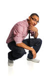 Young Man Crouching Stock Images