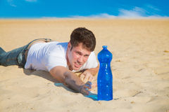 Young man crowling to water Stock Images
