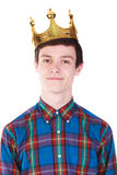 Young  man with crown isolated on white. Young handsome smilling man with crown isolated on white background Royalty Free Stock Images