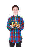 Young  man with crown isolated on white. Young handsome smilling man with crown isolated on white background Stock Photos