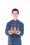 Young  man with crown isolated on white. Young handsome smilling man with crown isolated on white background Stock Image