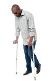 Young man with crutches trying to walk Royalty Free Stock Images