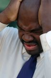 Young man crying. Young businessman in deep trouble Royalty Free Stock Photo