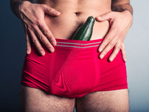 Young man with cucumber in his underpants Stock Image