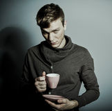 Young man with a cup of coffee Royalty Free Stock Image