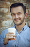 Young man with cup of coffee Royalty Free Stock Images